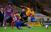2019 / 2020 Premier League - Wolverhampton Wanderers vs Crystal Palace <br /> <br /> James McCarthy of Crystal Palace and Adama Traore of Wolverhampton Wanderers at Molyneux.<br /> <br /> Credit COLORSPORT/LYNNE CAMERON