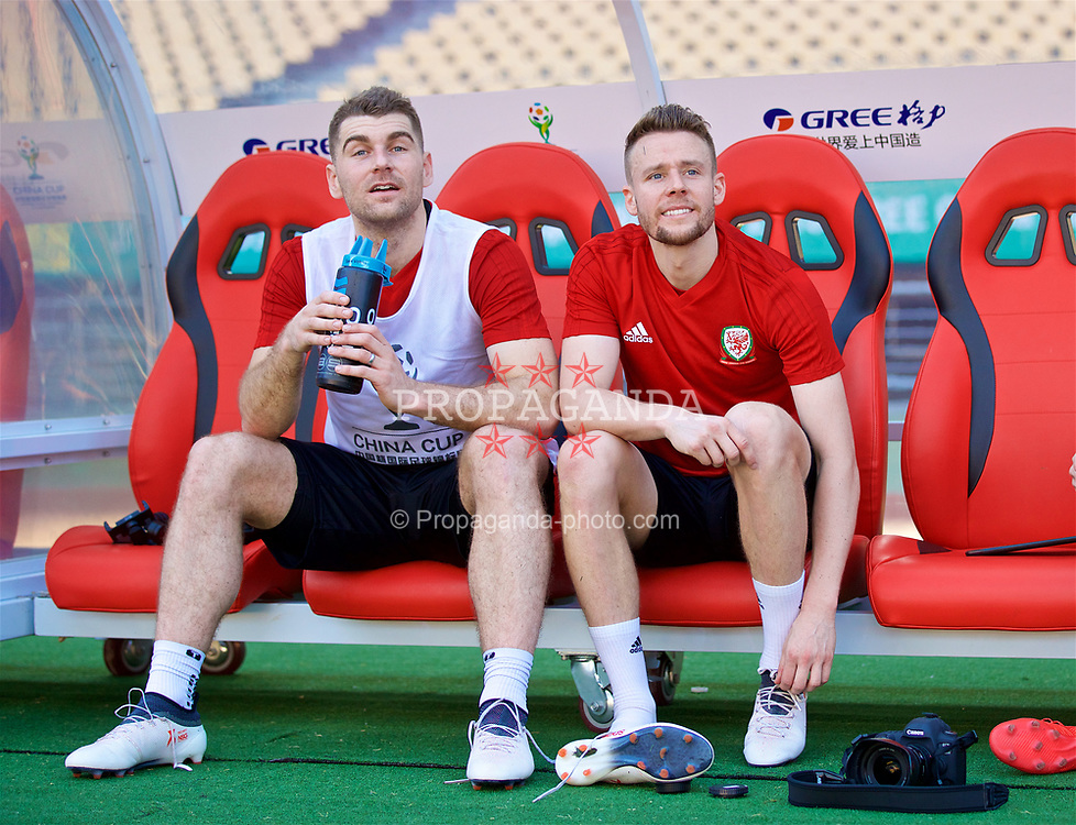 NANNING, CHINA - Tuesday, March 20, 2018: Wales' Sam Vokes and Chris Gunter during a training session at the Guangxi Sports Centre ahead of the opening 2018 Gree China Cup International Football Championship match against China. (Pic by David Rawcliffe/Propaganda)