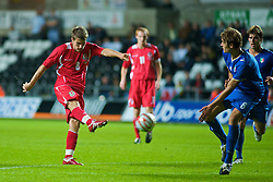 SWANSEA, ENGLAND - Friday, September 4, 2009: Wales' Aaron Ramseyscores the winning goal with a wonder strike to seal a 2-1 victory over Italy during the UEFA Under 21 Championship Qualifying Group 3 match at the Liberty Stadium. (Photo by Gareth Davies/Propaganda)