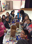 HISD students preparing USO donations.
