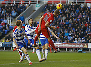 Blackburn Rovers striker, Jordan Rhodes leaps high but can't get enough contact on the ball to challenge the keeper during the Sky Bet Championship match between Reading and Blackburn Rovers at the Madejski Stadium, Reading, England on 20 December 2015. Photo by Andy Walter.
