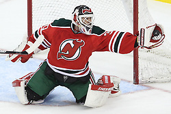 Mar 17; Newark, NJ, USA; New Jersey Devils goalie Martin Brodeur (30) makes a save during the third period of their game against the Pittsburgh Penguins at the Prudential Center. The Penguins defeated the Devils 5-2.