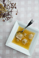 "Ducks in a Lake ""pillow"" (duck confit-filled pasta floating in a rich, truffle-scented duck broth at Liluma Side Door in St. Louis, MO."