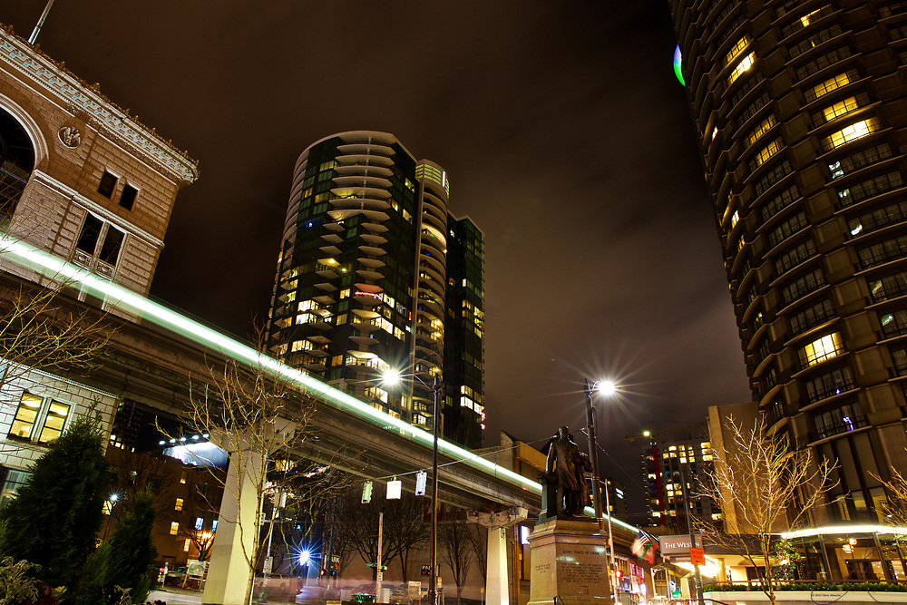 The monorail streaks into Westlake Center, gliding effortlessly over 5th Avenue in the heart of downtown Seattle.
