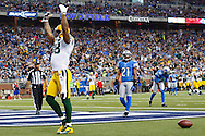 Green Bay Packers tight end Jermichael Finley (88) celebrates his touchdown as Detroit Lions cornerback Jacob Lacey (21) and defensive back Don Carey (32) react in the second quarter of an NFL game at Ford Field in Detroit, Sunday, Nov. 18, 2012. (AP Photo/Rick Osentoski)