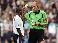 Biting incident : Jermaine Defoe (Spurs) is booked by Referee, Steve Bennett after biting  Javier Mascherano (West Ham) on his shoulder. BARCLAYS PREMIERSHIP. TOTTENHAM HOTSPUR v WEST HAM UNITED. 22/10/2006. CREDIT COLORSPORT / KIERAN GALVIN