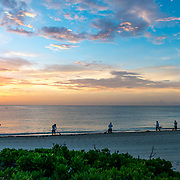 Hotel workers cleaning seaweed from the beach. Banyan Tree Mayakoba. Riviera Maya. Quintana Roo, Mexico.