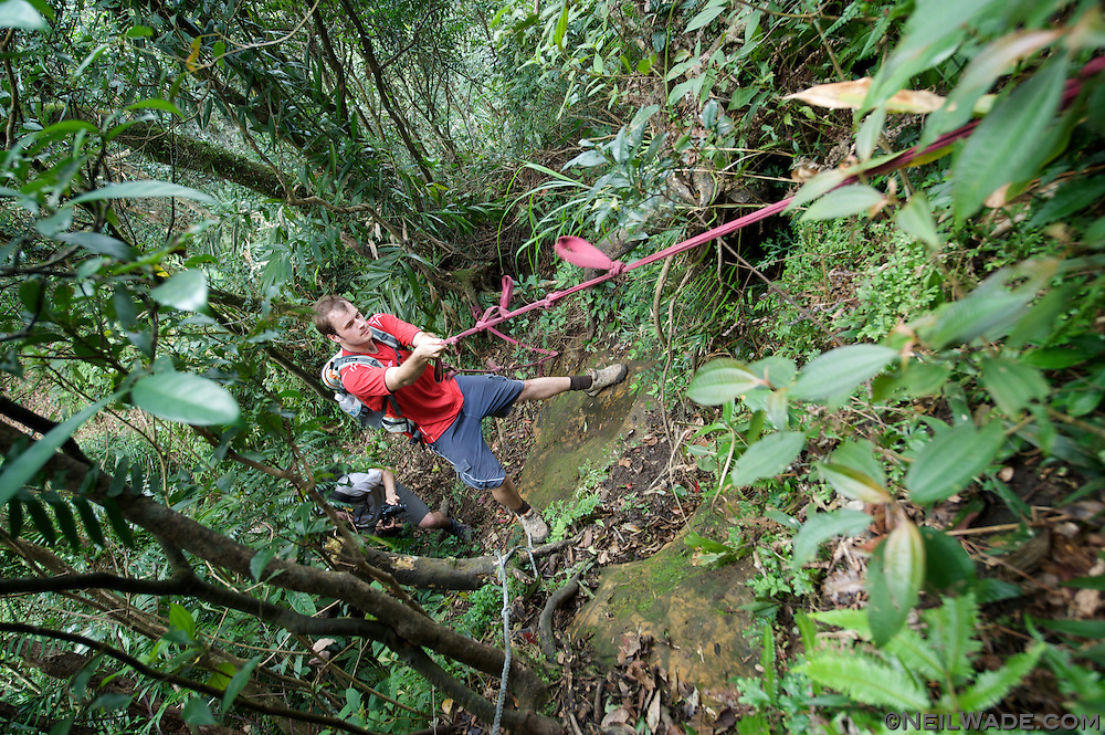 Rappeling down a steep hiking trail in northern Taiwan.