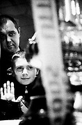 Father and son view FA cup in Megastore, London, U.K 1997.
