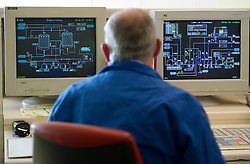 Rudy De Jonghe, works in the control room at the Solvay SA chemical plant in Antwerp, Belgium, on Thursday, April 22, 2010. Chlorine is the main product produced at Solvay's Antwerp facility.  Solvay SA is the world's largest supplier of Soda Ash or Sodium Carbonate and is also a major producer of caustic soda, hydrogen peroxide, chlorine and fluorinated products. (Photo © Jock Fistick)