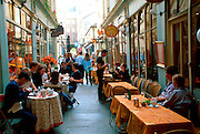 FRANCE, PARIS, LEFT BANK cafes on narrow alley between Rue Saint Andres des Artes and Rue Mazet in the St. Germain area