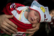 Three-day-old Amina in her grandmother Sawsan's arms in their home in the old quarter of Mosul.