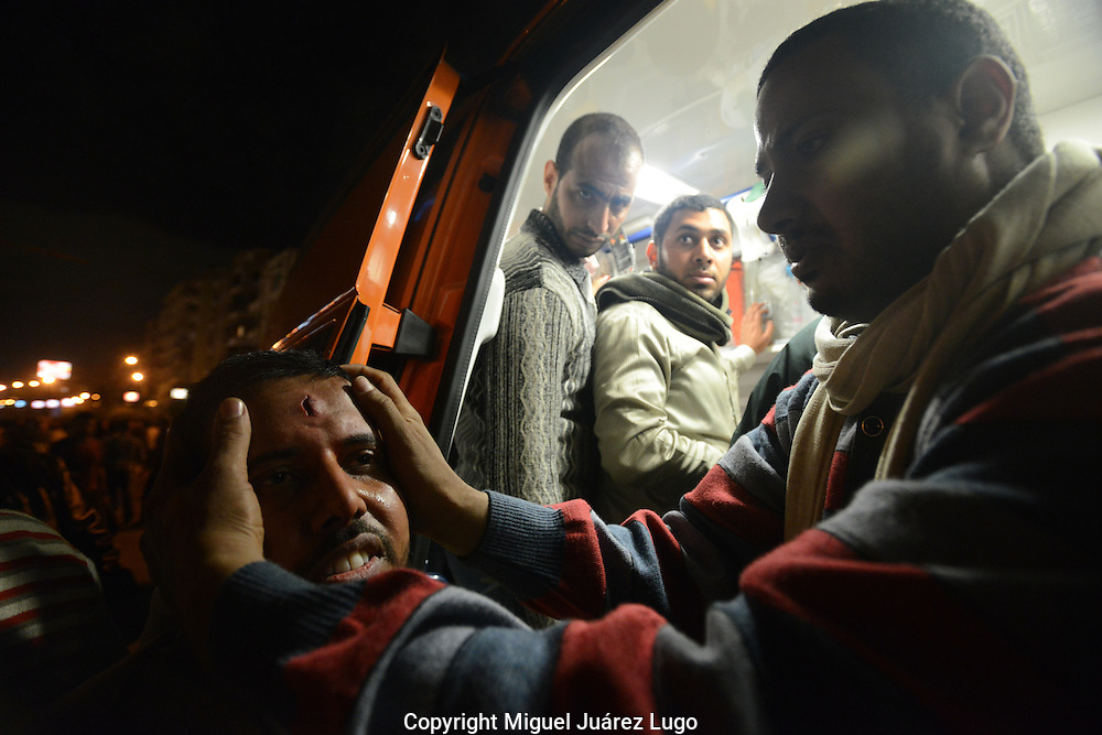 Cairo, Egypt, Dec. 5, 2012- A Muslim Brotherhood supporter of President Mohamed Morsi is treated at an ambulance after being hit with a rock thrown by opposition protesters during clashes in front of the presidential palace. Egypt's revolutionaries have divided, with Islamists backing Morsi on one side, and young liberal, secular and non-Islamists on the other.  (Photo by Miguel Juarez Lugo)