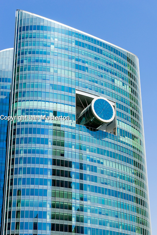 Unusual architectural design of glass office tower in Dubai United Arab Emirates