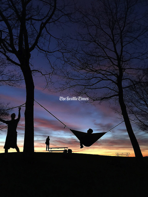 A beautiful sunset At Edmonds Marina Beach Park brought out many people just wanting to bask in it. <br /> <br /> Dean Rutz / The Seattle Times