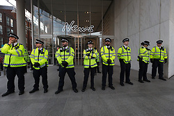 © Licensed to London News Pictures. 24/06/2016. LONDON, UK.  Police line shortly before demonstrators and supporters from Movement for Justice staged a protest against xenophobia, racism and anti-immigrant policies outside News UK (formerly News International) headquarters in London following the result of the European Referendum. Protesters believe the tone of anti-immigrant politics has been set by the mainstream media, including Rupert Murdoch publications and television.  Photo credit: Vickie Flores/LNP
