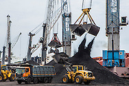 Coal is offloaded through Mobile Harbour Cranes from a ship at  Krishnapatnam port, Andhra Pradesh, on Monday, June 15, 2015.Photographer: Prashanth Vishwanathan/Bloomberg