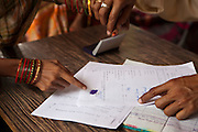 Signing the paper work. A woman from a rural slum in the Orissa district of India gets legal advice and birth certificates from a Legal Aid Clinic run by the organisation CLAP. Committee for Legal Aid to Poor (CLAP) is a non-profit organisation helping to provide legal aid to the poorer communities in the Orissa district of India.