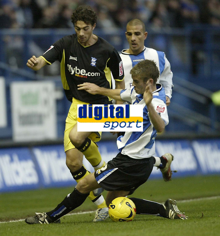 Photo: Aidan Ellis.<br /> Sheffield Wednesday v Birmingham City. Coca Cola Championship. 16/12/2006.<br /> Sheffield's Tommy Spurr slides in to stop Birmingham's Stephen Kelly