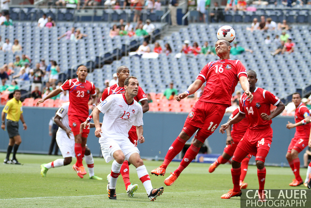July 14 2013:  Panama Forward Rolando Blackburn (16) heads the ball off of a Canada corner kick during the CONCACAF Gold Cup soccer match between Panama and Canada at Sports Authority Field in Denver, CO. USA.