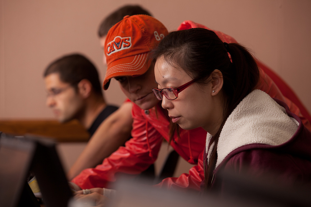 International student Xiumin Jin of China (Right) complete her tax forms with the assistance of student volunteer Lindsey Marginian at a income tax assistance program offered by the College of Business at Ohio University.
