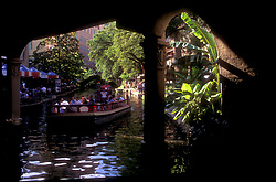 Boat floating down the Riverwalk in San Antonio, Texas