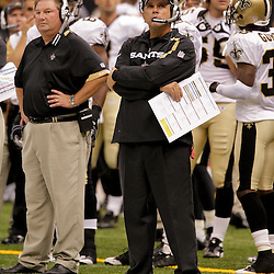 2009 September 03: New Orleans Saints head coach Sean Payton watches from the sideline during a preseason game between the Miami Dolphins and the New Orleans Saints at the Louisiana Superdome in New Orleans, Louisiana.