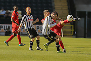 Notts County defender Elliot Hewitt gets one in the face from York City midfielder Josh Carson during the Sky Bet League 2 match between Notts County and York City at Meadow Lane, Nottingham, England on 26 September 2015. Photo by Simon Davies.