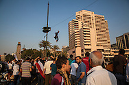 Egyptians celebrate by jumping into the Nile, after news of the country's president Morsi has been arrested by the military.