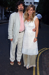 SIR TREVOR NUNN and his wife IMOGEN STUBBS at Sir David & Lady Carina Frost's annual summer party held in Carlyle Square, Chelsea, London on 5th July 2006.<br />