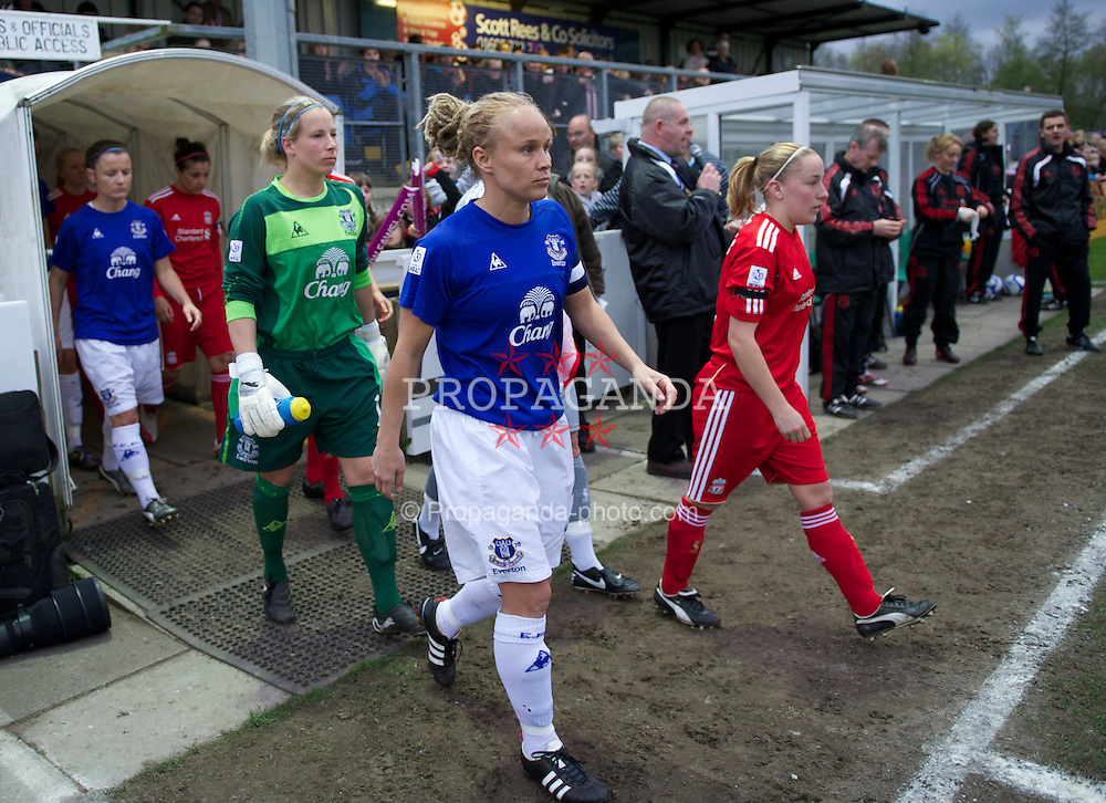 SKELMERSDALE, ENGLAND - Thursday, April 14, 2011: Everton's captain Jody Handley and Liverpool's captain Vicky Jones lead the side out before the opening FA Women's Super League match at Stoney Corner. (Photo by David Rawcliffe/Propaganda)