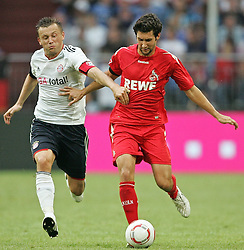 31.07.2010,  Veltnis-Arena, Gelsenkirchen, GER, 1.FBL, FC Bayern Muenchen - 1. FC Koeln, Liga total! Cup 2010, im Bild Ivica Olic (Muenchen #11) / Mato Jajalo (Koeln #19)  EXPA Pictures © 2010, PhotoCredit: EXPA/ nph/  Mueller+++++ ATTENTION - OUT OF GER +++++ / SPORTIDA PHOTO AGENCY