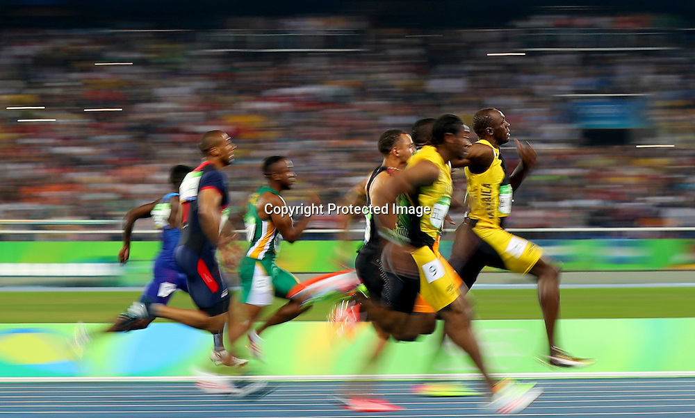Rio 2016 Olympic Previews Day 1, Rio de Janeiro, Brazil 14/8/2016<br />Athletics - Men's 100m Final<br />Jamaica's Usain Bolt on his way to winning the 100m Final<br />Mandatory Credit &copy;INPHO/James Crombie