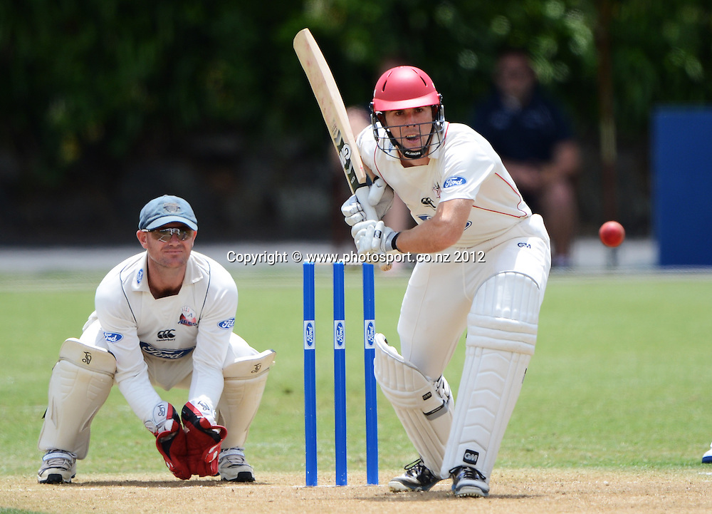 Canterbury's Todd Astle as Gareth Hopkins looks on. Plunket Shield Cricket, Auckland Aces v Canterbury Wizards at Eden Park Outer Oval. Auckland on Sunday 16 December 2012. Photo: Andrew Cornaga/Photosport.co.nz