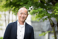 Portrait of smiling Japanese man looking to camera. Happy Asian businessman in his 40's .