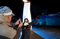 Visitors love to take their photo with the Olympic flame in the medals plaza during the 2010 Olympic Winter Games in Whistler, BC Canada.