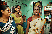 "India's Transgender Women<br /> "" Trans But Still A Human ""<br /> <br /> It is a natural desire and curiosity for a human to inquire about his/her future. Although difficult, it is somehow possible in a number of ways.<br /> For ""Saranya"", this happened at the early age of 11. Her parents had hopes and dreams for their second child after having their baby daughter; However,  they were faced with a boy whose playmates were among girls .  Instead of feeling protected and at peace among her family, Saranya always felt stress and tension. Although not yet aware of her real sexuality and the fact that she is a trans woman, Saranya eventually learned to hide things from others. This sparked the beginning of the pain and fear which made life bitter and unpleasant for her. Every time she felt the natural, feminine side of her emerging , she had to deal with severe punishment and offensive reactions which only turned those feelings to ashes.  Exhausted, suppressed , and always judged  with undisguised contempt, she finally left her biological family at the age of sixteen and took refuge in her future family. She escaped from Pune and ventured to Bangalore in South India , In State of Karnataka.<br /> Transsexual or Trans genders are usually known as Hijras in India and Pakistan. Hjras are also known as Chhakka in Kannada and Bambaiya Hindi, Khusra in Punjabi and Kojja In Telegu . The word Hijra is an Urdu word meaning eunuch or hermaphrodite. Their communities also have women who are unable to act and live as a normal women with rights to get married and have children. A great number of Hijras are men who identify themselves as more feminine than masculine. Most Hijras do not have sexual desires for women.. They are described as "" man minus maleness"" and "" man plus woman"". In the Indian culture, there is so much focus and emphasis on a woman`s ability to have children ; therefore, hijras who are unable to reproduce are considered as a separate identity that can not fit into any category of ma"