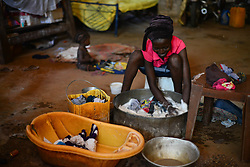 July 3, 2017 - Wau, Wau, South Sudan - An internal displaced woman, washes her clothes with in the grounds of the St. Mary's Help of Christian Parish Cathedral in Wau South Sudan on Monday.   Thousands of South Sudanese found refuge with in the grounds of the church since June 2016. (Credit Image: © Miguel Juarez Lugo via ZUMA Wire)