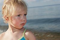 Young girl (3-4) at ocean
