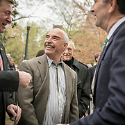 Virginia Governor Ralph Northam, right, greets Ken Branham, center, former Chief of Monacan Nation, and former Va Gov. George Allen, during the dedication ceremony for Mantle: Virginia Indian Tribute, a monument designed on Virginia State Capitol Square, in Richmond, Virginia, on Tuesday, April 17, 2018. John Boal Photography