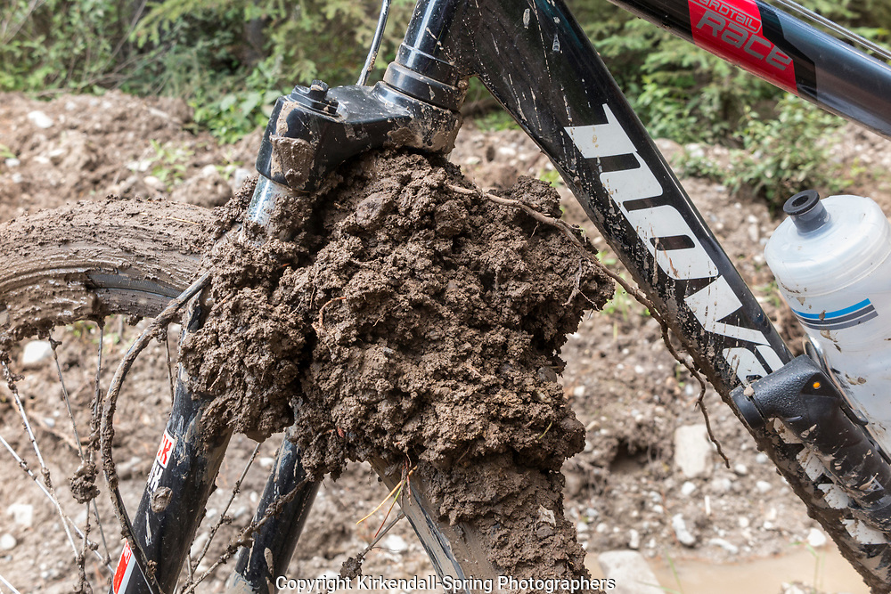 BC00619-00...BRITISH COLUMBIA - Vicky Spring had her front wheel pack up with wet sticky gooey mud so bad it stoped her wheel from moving.