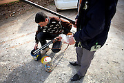 Young villagers loading old rifles with selfmade bullets to defend themselfs. On 22. February the syrian army attacked the village of Kureen, Province of Idlib, Syria. Kureen was among the first villages in the northwest of Syria controlled by the opposition. Some villagers and members of the defence units escaped to surrounding olive orchards, when the attack begun in the early morning. A majority of the inhabitants didn´t manage to escape. The heavy shelling lasts 7 houres. Soldiers searched all houses, burnt some of them down, loote shops, stole cars and furniture. About 60 motorcycles were burnt down. Tanks demolished several houses. 6 men were executed. One woman died as a result of an heart attack.
