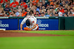 May 31, 2018 - Houston, TX, U.S. - HOUSTON, TX - MAY 31: Houston Astros starting pitcher Lance McCullers Jr. (43) goes down after colliding with Boston Red Sox third baseman Rafael Devers (11) in the second inning during an MLB baseball game between the Houston Astros and the Boston Red Sox, Thursday, May 31, 2018 in Houston, Texas. (Photo by Juan DeLeon/Icon Sportswire) (Credit Image: © Juan Deleon/Icon SMI via ZUMA Press)