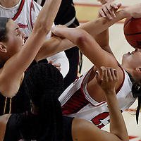 IUPUI's Allex Brown fouls against USD's Madison McKeever during their game at USD Sanford Coyote Sports Center on Saturday in Vermillion.