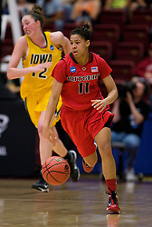 March 20, 2010; Stanford, CA, USA; Rutgers Scarlet Knights guard Nikki Speed (11) dribbles past Iowa Hawkeyes center Morgan Johnson (12) during the second half in the first round of the 2010 NCAA womens basketball tournament at Maples Pavilion.  Iowa defeated Rutgers 70-63.
