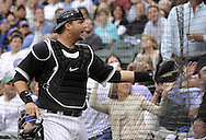 CHICAGO - JUNE 22:  A.J. Pierzynski #12 of the Chicago White Sox attemts to catch a fould pop up against the Chicago Cubs on June 22, 2011 at U.S. Cellular Field in Chicago, Illinois.  The White Sox defeated the Cubs 4-3.  (Photo by Ron Vesely)  Subject:   A.J. Pierzynski