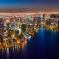 Aerial view of Brickell and downtown Miami waterfront at twilight.