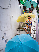 29 SEPTEMBER 2016 - BANGKOK, THAILAND: Children who live in Pom Mahakan line the steps of the city wall during a rally in support of the Pom Mahakan community. Forty-four families still live in the Pom Mahakan Fort community. The status of the remaining families is not clear. Bangkok officials are still trying to move them out of the fort and community leaders are barricading themselves in the fort. The residents of the historic fort are joined almost every day by community activists from around Bangkok who support their efforts to stay.     PHOTO BY JACK KURTZ