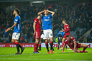 Gareth McAuley (#36) of Rangers FC has his head in his hands after missing a header in the last moments of the Ladbrokes Scottish Premiership match between Rangers and Aberdeen at Ibrox, Glasgow, Scotland on 5 December 2018.