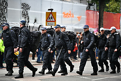 © Licensed to London News Pictures. 26/08/2018. London, UK. A heavy police presence on family day of the 2018 Notting Hill Carnival. Up to 1 million people are expected to attend this weekend's event that is one of the worlds largest street festivals. Photo credit: Ben Cawthra/LNP